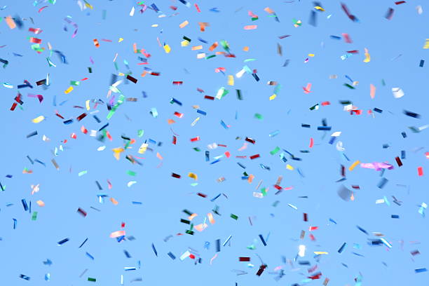 confetti celebration - confetti stok fotoğraflar ve resimler