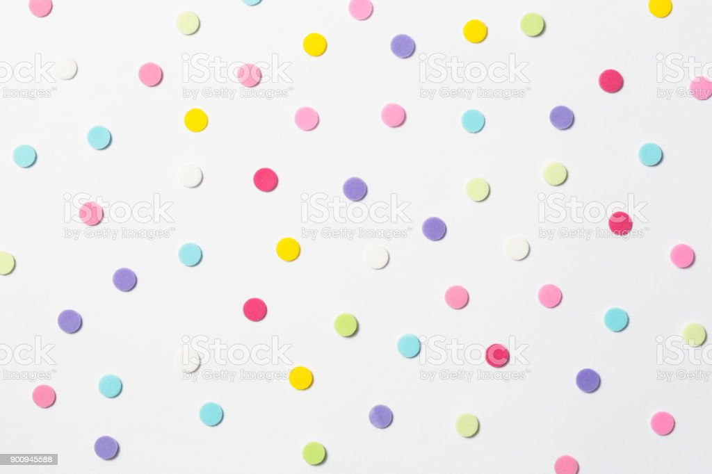 Confetti. Colorful dots view from above on a light background. Top view stock photo