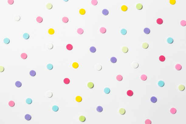 confetti. colorful dots view from above on a light background. top view - spotted stock pictures, royalty-free photos & images