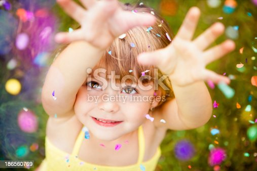 istock Confetti Falling On Little Girl 186560769