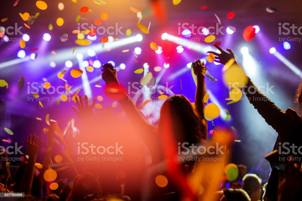 Confetti falling over the crowd royalty-free stock photo