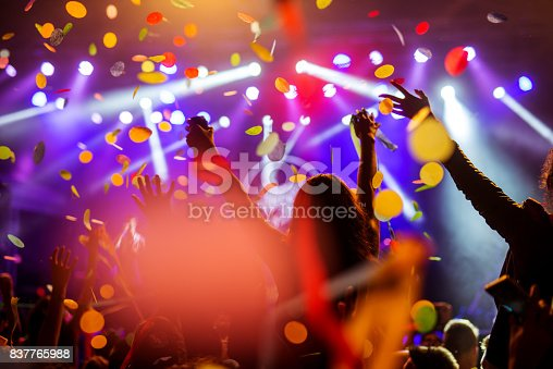 Confetti falling over the crowd on a music festival.