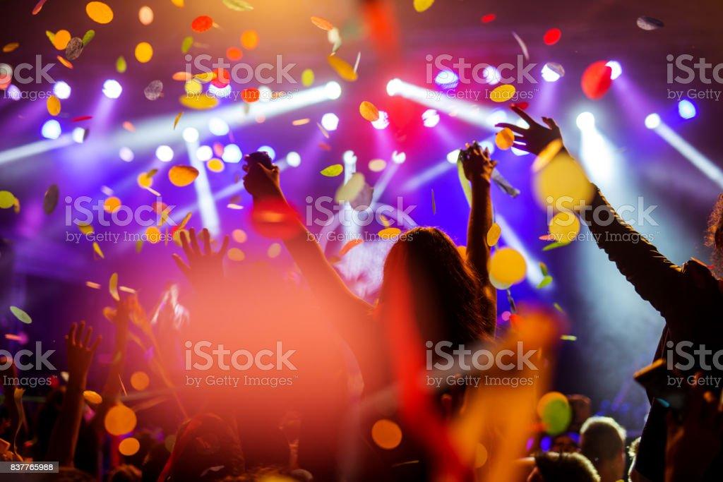 Confetti falling over the crowd stock photo