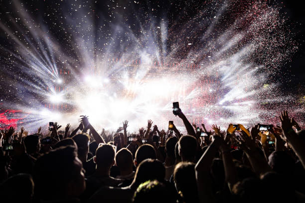 confetti fireworks above the crowd on music festival. - music style stock pictures, royalty-free photos & images