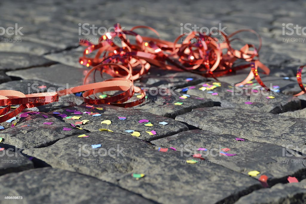 Confetti from a party left on floor stock photo