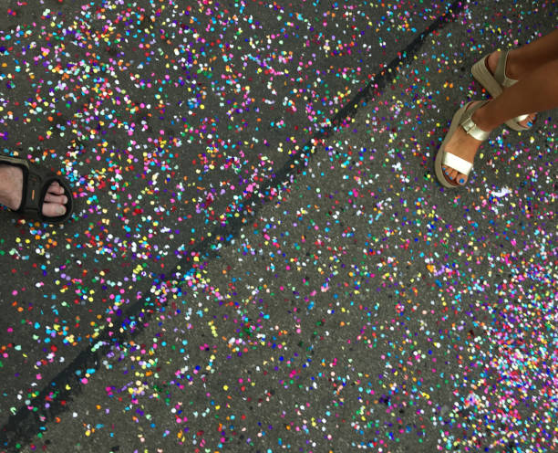 Confetti on the ground between two people stock photo