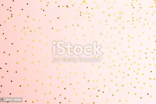 1040055260istockphoto Confetti on the pink background 1085918966