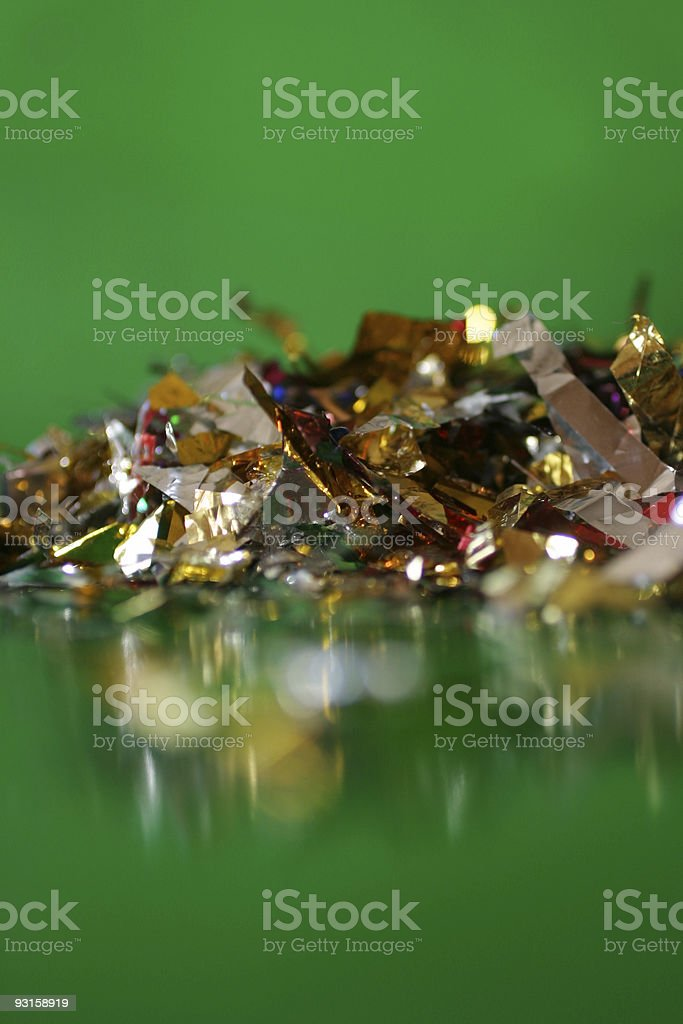 Confetti pile and reflection stock photo