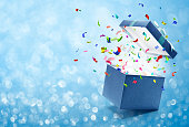 istock Confetti popping out from gift box 653007528