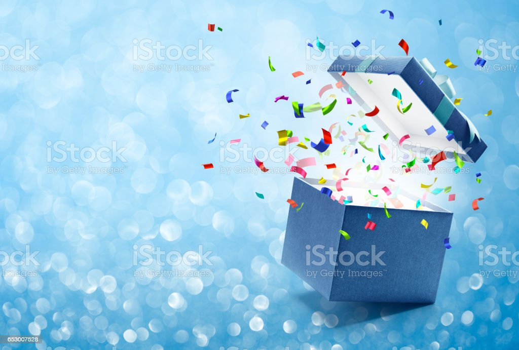 Confetti popping out from gift box - foto de stock