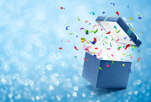 confetti popping out from gift box - birthday gift stock photos and pictures