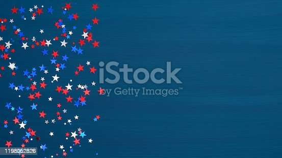 971061452 istock photo Confetti stars in American flag colors on blue background. USA Independence Day, Presidents Day, American Labor day, Memorial Day, US election concept. 1198052826