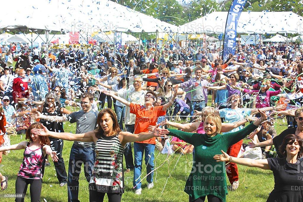 Confetti, streamers, outdoor community festival 'flash mob' dancers stock photo