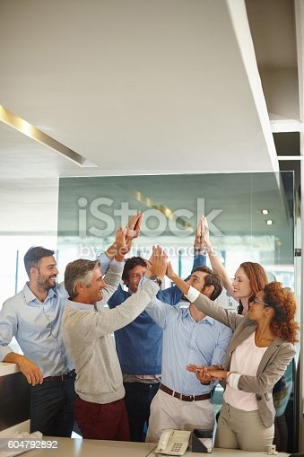 istock Confidence and positivity - wining attributes of a successful team 604792892