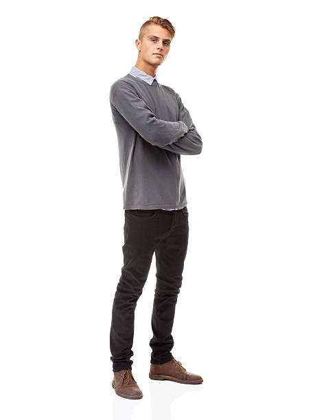 Confidence and presence - He's got them both! A full length studio shot of a stylishly dressed young man isolated on whitehttp://195.154.178.81/DATA/i_collage/pi/shoots/781221.jpg skinny jeans stock pictures, royalty-free photos & images