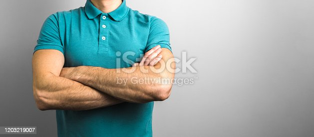 1045886560 istock photo confidence and reliability. closeup crossed arms of a man on grey background with copy space 1203219007