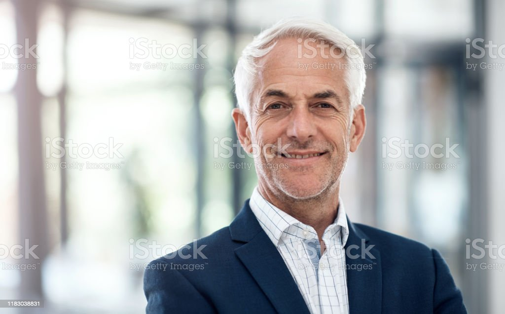 Confidence and success go hand in hand Portrait of a confident mature businessman working in a modern office 50-59 Years Stock Photo