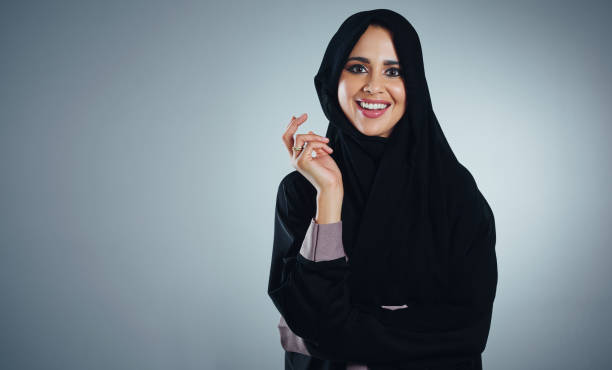 Confidence begins with a smile Studio portrait of a young muslim businesswoman against a grey background arabia stock pictures, royalty-free photos & images