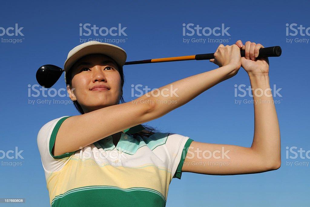Confidence Female Golfer Swing royalty-free stock photo