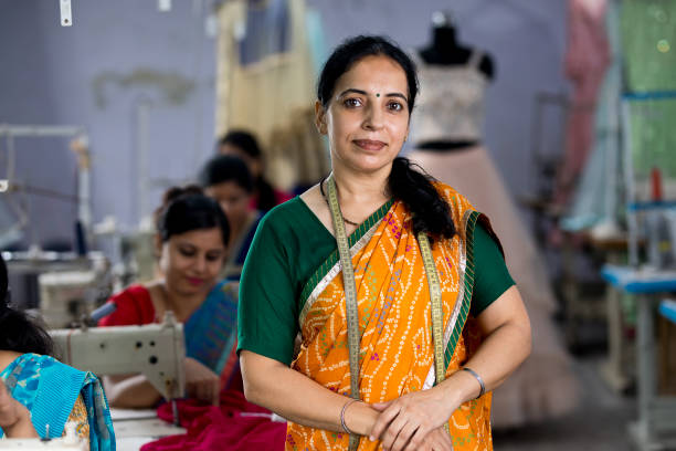 Confidence female inspector at textile factory stock photo