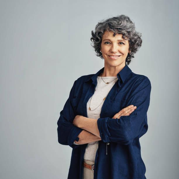 förtroende är inte definieras av min ålder - mature women studio grey hair bildbanksfoton och bilder