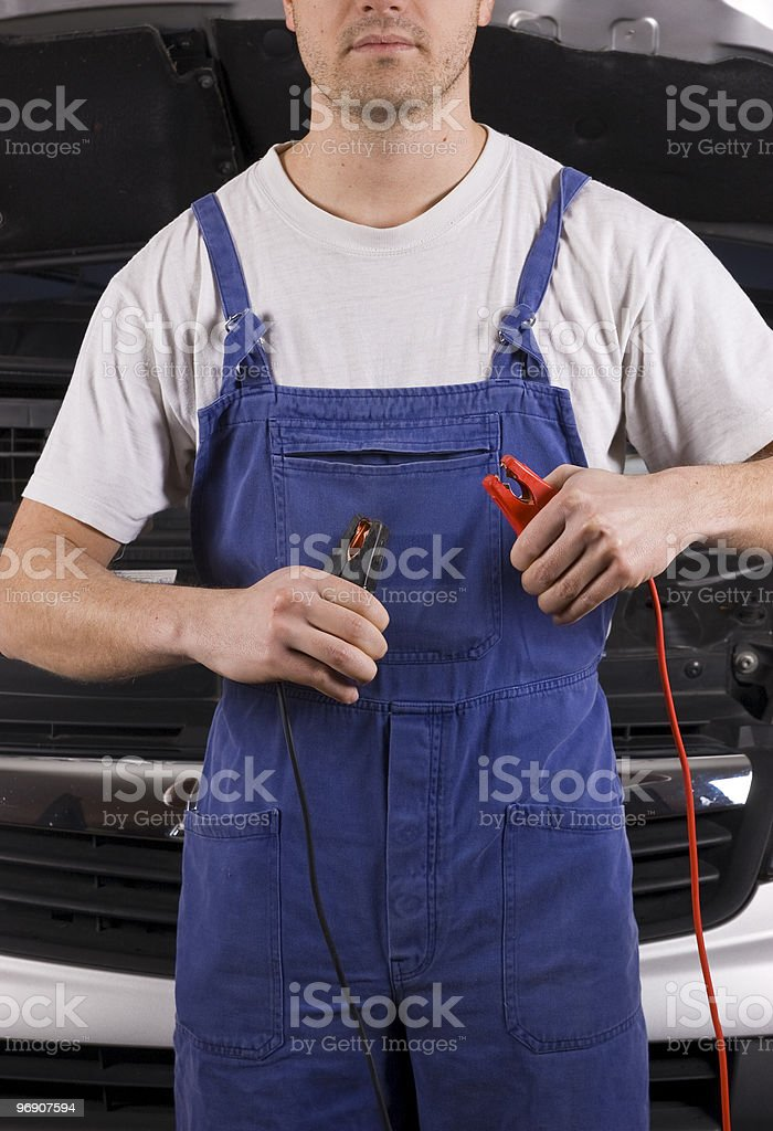 Confidence mechanic with jumper cable royalty-free stock photo