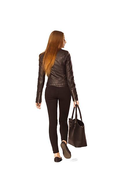 Vertrauen junge Frau Rücken Porträt in Schwarz an Einkaufsmöglichkeiten. – Foto