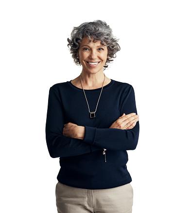 Studio portrait of a confident mature woman posing against a white background