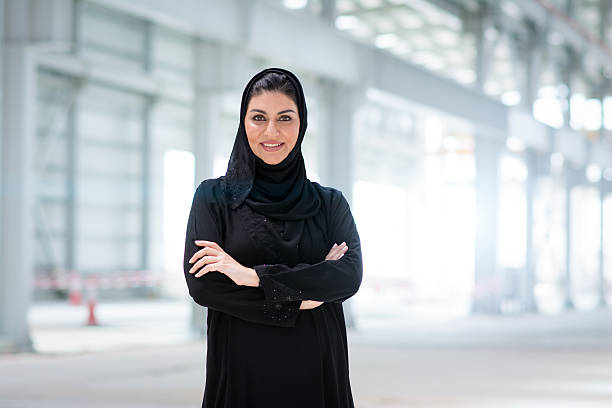 Confident about this Construction Site Business woman in abaya looking at camera. She is proud of the project she is manager of. arabia stock pictures, royalty-free photos & images