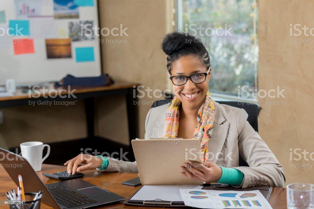 Confident accountant reviews client's file stock photo