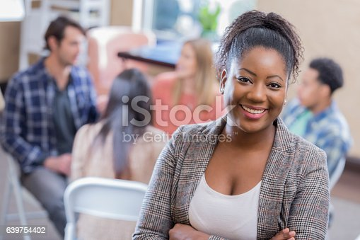 istock Confident African American counselor in front of support group 639754402