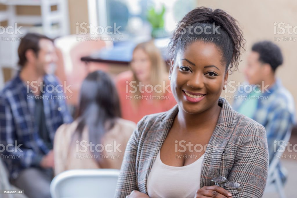 Confident African American woman attends support group stock photo