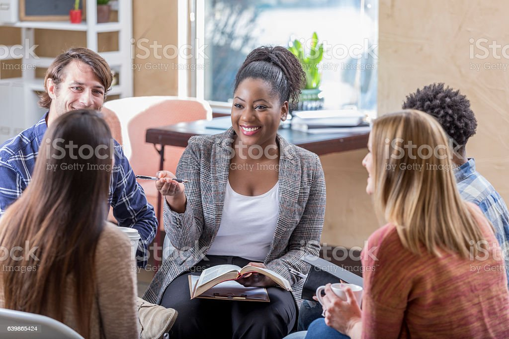 Confident African American woman leads Bible study stock photo