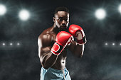 istock Confident african boxer standing in pose and ready to fight 1174436999