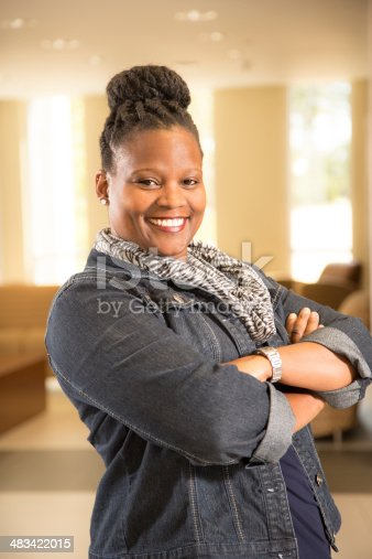 istock Confident African descent woman in office setting. 483422015