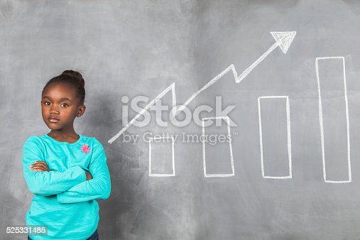 istock Confident african girl showing off her savings growth. 525331485