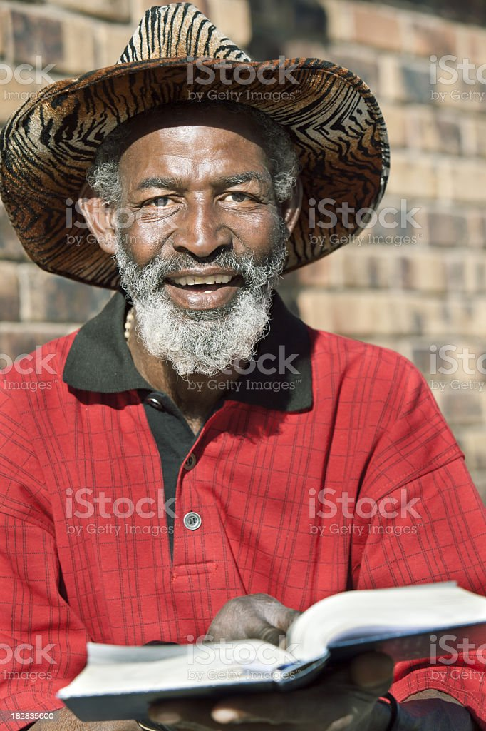 Confident African Man Reading stock photo