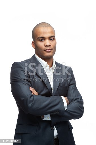 475529255 istock photo Confident African-American Businessman in a stylish suit. 1128703451