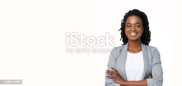 Millennial Businesswoman. Confident black woman in suit posing with folded arms on white background, horizontal banner, wide long shot, panorama