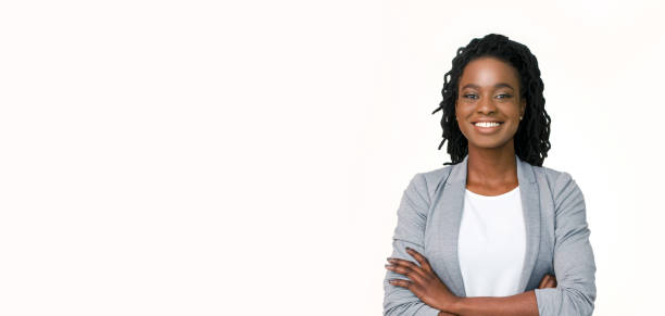 Confident afro businesswoman posing with folded arms on white background Millennial Businesswoman. Confident black woman in suit posing with folded arms on white background, horizontal banner, wide long shot, panorama african american ethnicity stock pictures, royalty-free photos & images