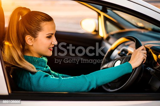 627864748 istock photo Confident and beautiful in car 889108666