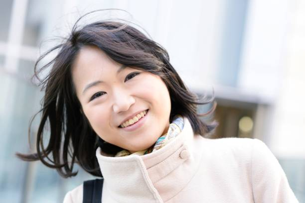 Confident and cheerful young woman stock photo