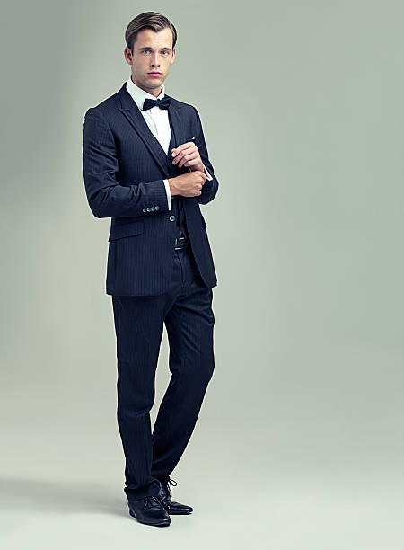 Confident and classic A full length studio shot of a handsome young man in a stylish vintage suit tuxedo stock pictures, royalty-free photos & images