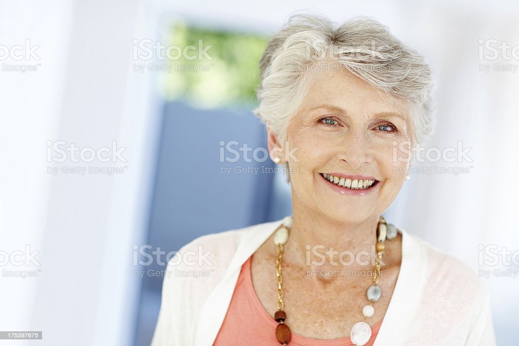 Confident and content senior woman royalty-free stock photo