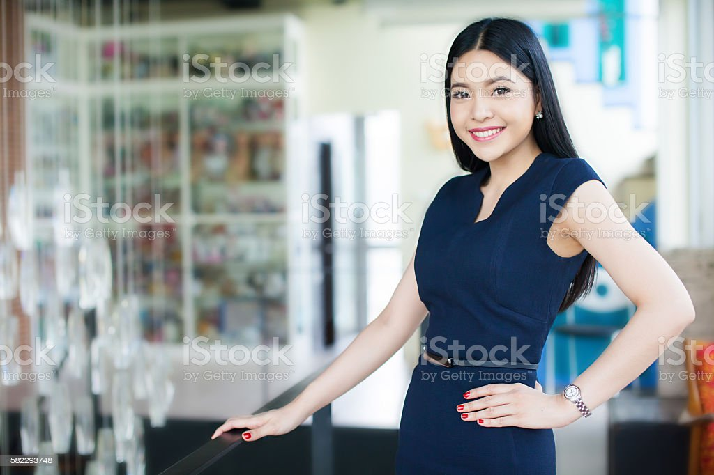Confident and Smart Asian woman in office background stock photo