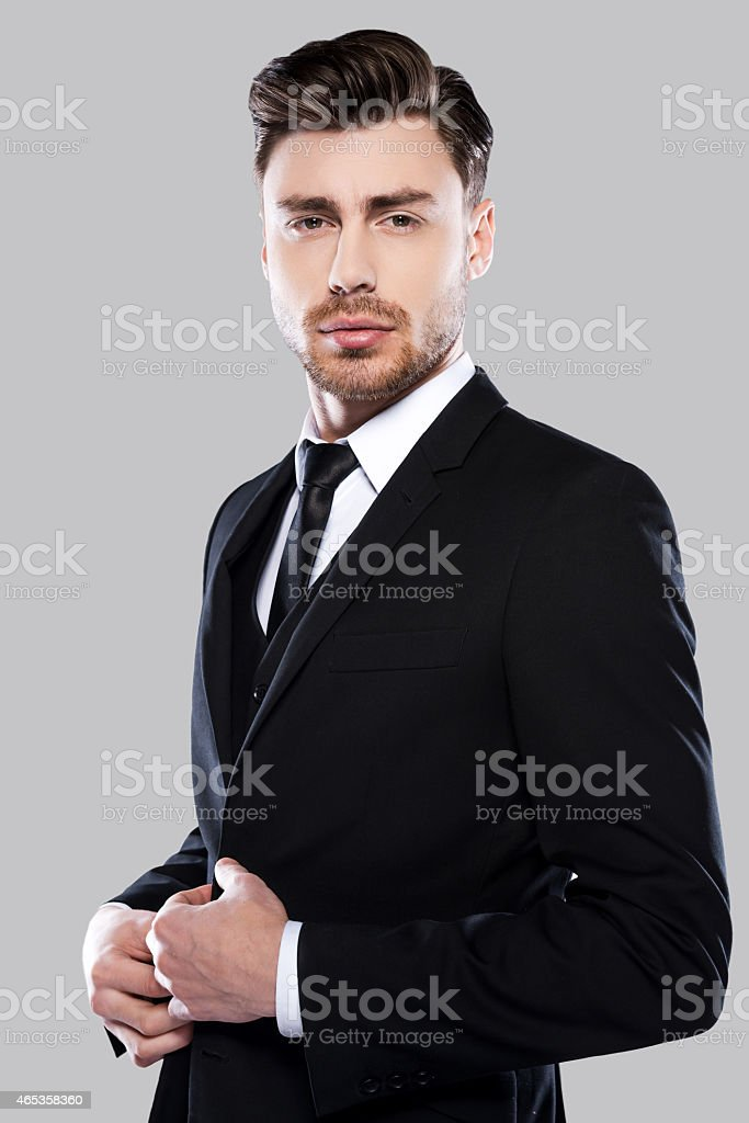 Confident and successful businessman in black suit stock photo