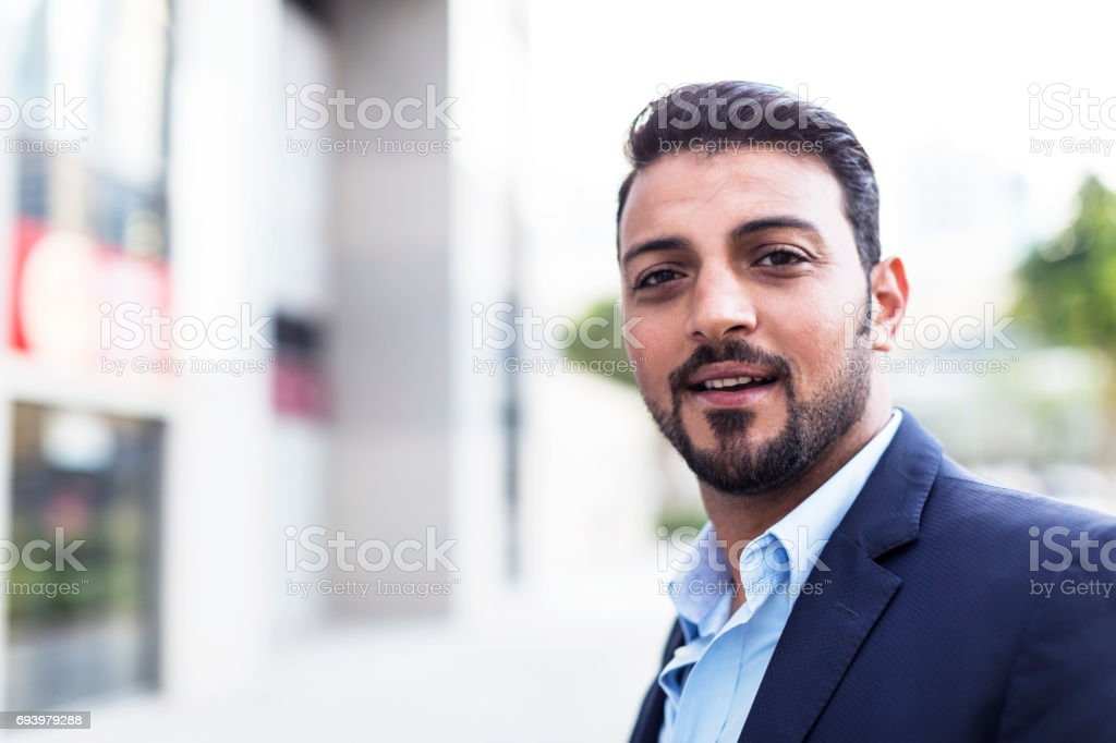 Confident Arab Businessman smiling at the camera stock photo