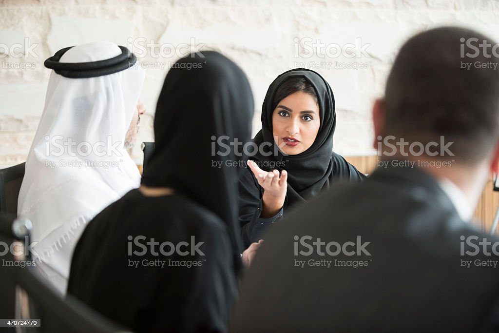 Confident Arab businesswoman in business meeting stock photo