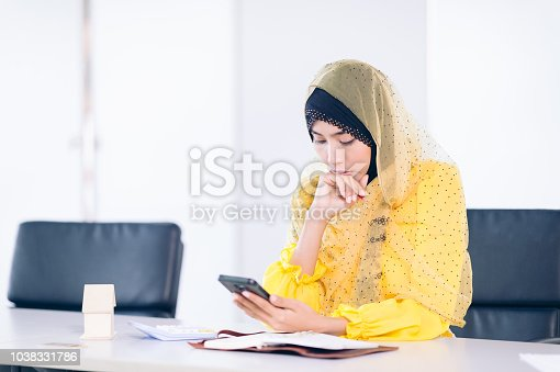 istock Confident Arabian Businesswoman working space.Smile Female arab thinking something at work place 1038331786
