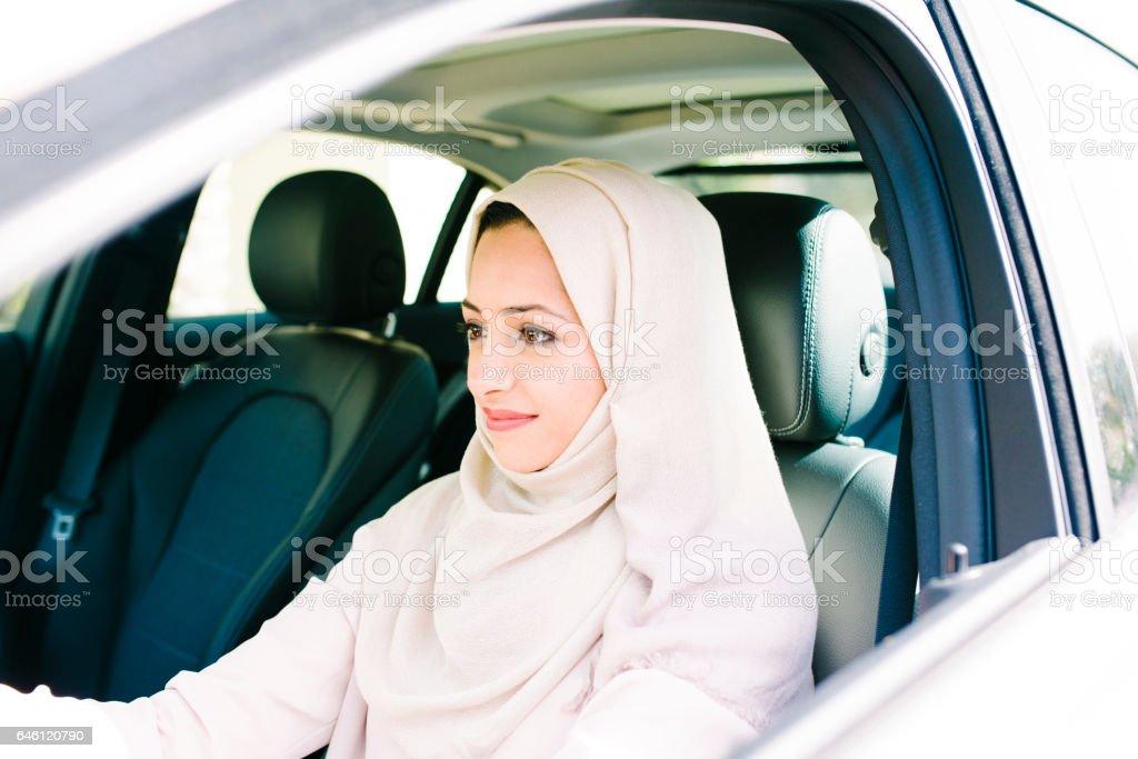 Confident Arabic woman driving stock photo